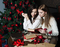 Beautiful girls in expectation of New Year royalty free stock image