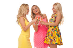 Beautiful girls in fashion dresses with champagne Royalty Free Stock Photos