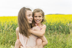 Beautiful girls in a field of yellow flowers Stock Photos