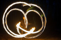 Beautiful girls fireshow in the dark Royalty Free Stock Photo