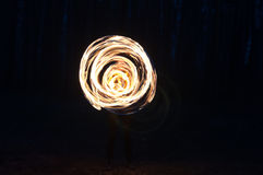 Beautiful girls fireshow in the dark Stock Photography