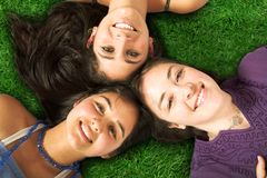 Beautiful girls on the floor outdoors Royalty Free Stock Images