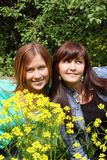 Beautiful girls  in flowers Royalty Free Stock Image