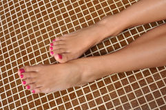 Beautiful girls foot. With pink nails Royalty Free Stock Photography