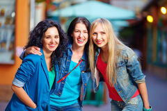 Beautiful girls friends on evening city street Royalty Free Stock Images