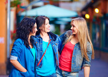Beautiful girls friends on evening city street Royalty Free Stock Image