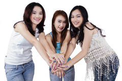 Beautiful girls gathering hands in studio Royalty Free Stock Photo