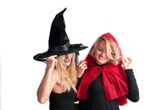 Beautiful girls in halloween costume witch and little red riding hood. On white background Stock Photo