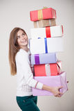 Beautiful girls in the hands many gifts Royalty Free Stock Image