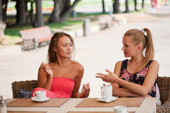 Beautiful girls has a rest in street cafe Royalty Free Stock Photo