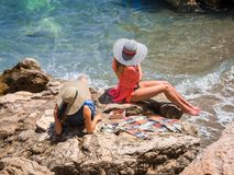 Beautiful girls in hats sunbathing Stock Photography