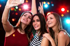 Beautiful girls have fun at a Christmas party royalty free stock photos