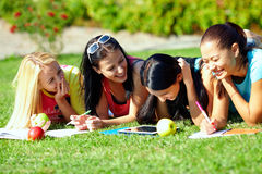 Beautiful girls having fun outdoors on green lawn Stock Photography