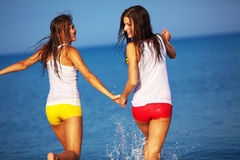 Girls in water Stock Photography