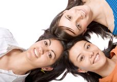 Beautiful girls with heads together Stock Images