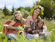 Beautiful girls of hippie in the field Royalty Free Stock Photography