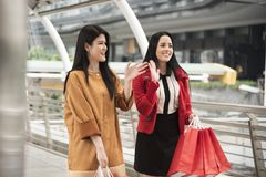 Beautiful girls holding shopping bags walking at shopping mall. Beautiful girls holding shopping bags walking at the shopping mall Stock Photos