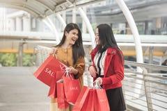 Beautiful girls holding shopping bags walking at shopping mall. Beautiful girls holding shopping bags walking at the shopping mall Stock Photo