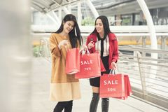 Girls holding shopping bags walking at the shopping mall. Beautiful girls holding shopping bags walking at the shopping mall Royalty Free Stock Photography