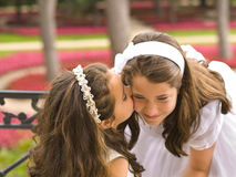 Beautiful girls kissing. In the park Stock Photos