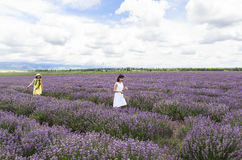 Beautiful Girls at Lavender fields of Xinjiang, China Royalty Free Stock Photography
