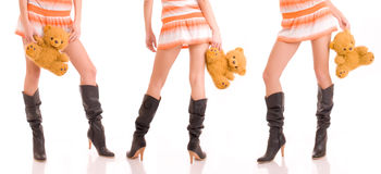 Beautiful girls legs and bears. Beautiful girls legs and teddy bears royalty free stock image