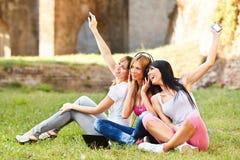 Beautiful girls listen free music Royalty Free Stock Photography