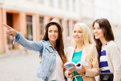 Beautiful girls looking for direction in the city Stock Photography