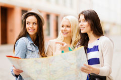 Beautiful girls looking for direction in the city Royalty Free Stock Photo