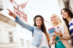 Beautiful girls looking for direction in the city Royalty Free Stock Photography
