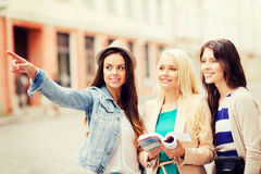 Beautiful girls looking for direction in the city Stock Image