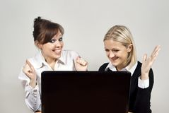 Beautiful girls looking laptop Royalty Free Stock Photos