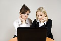 Beautiful girls looking laptop Stock Photo