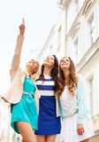 Beautiful girls looking at something in the city Stock Photography