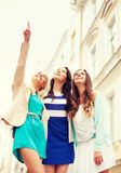 Beautiful girls looking at something in the city Royalty Free Stock Photo