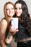 Beautiful girls making a self portrait with mobile Royalty Free Stock Photos