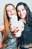 Beautiful girls making a self portrait with mobile Stock Photos