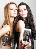 Beautiful girls making a self portrait with mobile Stock Image