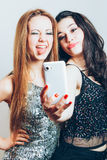 Beautiful girls making a self portrait with mobile Stock Images