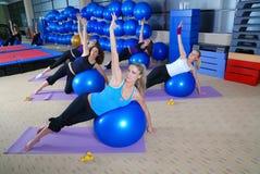 Beautiful girls meditating in fitness club Royalty Free Stock Photo