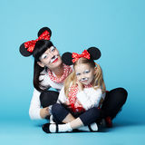 Beautiful girls with mouse masks stock photo