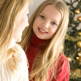 Beautiful girls next to the christmas tree Stock Images