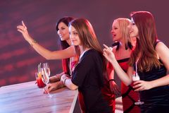Beautiful girls ordering drinks at the bar Stock Photo