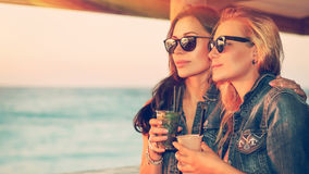 Beautiful girls in the outdoor cafe stock photography
