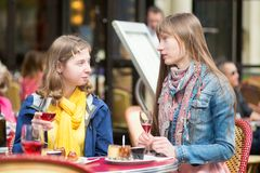 Beautiful girls in a Parisian cafe. Royalty Free Stock Photo