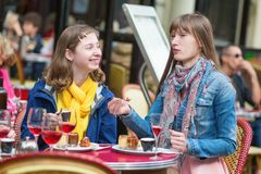 Beautiful girls in a Parisian cafe. Royalty Free Stock Photography