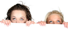 Beautiful girls peeking Stock Image