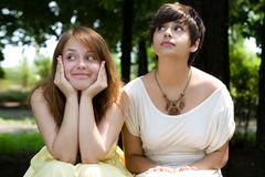 Beautiful girls posing in the park. Two pretty young girls posing outdoors Royalty Free Stock Photography