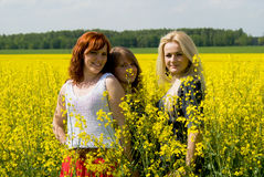 Beautiful girls on rapeseed field Royalty Free Stock Images