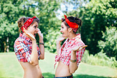 Beautiful girls on the rockabilly hen-party in park Royalty Free Stock Photography